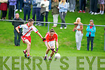 East Kerry's Paudie Clifford gets ahead of An Ghaeltacht's Cathal O Gairbhia Caoimhghin O Beaglaoich in the minor County championship final at Killorglin on Saturday.