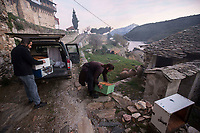 Mount Athos - The Holy Mountain.<br /> Monks empty beehives from a car in the early morning. <br /> <br /> Photographer: Rick Findler