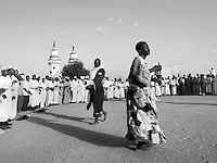 "Sufi Muslims dance and chant during a religious cermony in Khartoum, Sudan on July 29, 2005. Sometimes referred to as the ""whirling dervishes"", practitioners of the strongly mystical religion meet every Friday before sunset at the Hamed al Nil mosque in Omdurman. The Sufis attempt to reach a state of trance through the ritual."