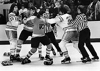California Golden Seals vs. Philadelphia Flyers..fight..<br />Seaals Jim Neilson, holding Flyer Rick MacLeish, Gary Domhoefer, and Seals Bob Girard. (1975 photo/Ron <br />Riesterer)