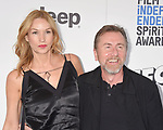SANTA MONICA, CA - FEBRUARY 25: Actor Tim Roth (R) and wife Nikki Butler attend the 2017 Film Independent Spirit Awards at the Santa Monica Pier on February 25, 2017 in Santa Monica, California.