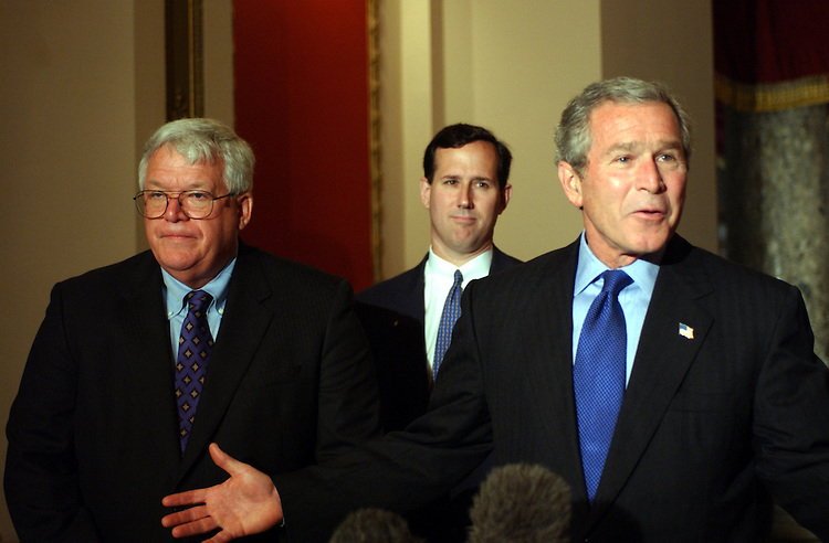 Bush3_052203 --  Speaker of the House J. Dennis Hastert, R-IL., Rick Santorum, R-PA., and President George W. Bush greet the press to talk about the visit to Congress to support the the tax bill.