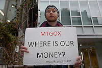Bitcoin trader, Kolin Burges, from the United Kingdom, protests in front of the abandoned offices of Tokyo-based Bitcoin exchange, Mt. Gox. Shibuya, Tokyo, Japan. Friday February 28th 2014. Mr Burges flew to Japan to personally confront the trading company over his inabilty to withdraw over 260,000 USD worth of the electronic currency. Mt. Gox officially filed for bankruptcy on February 28th 2014
