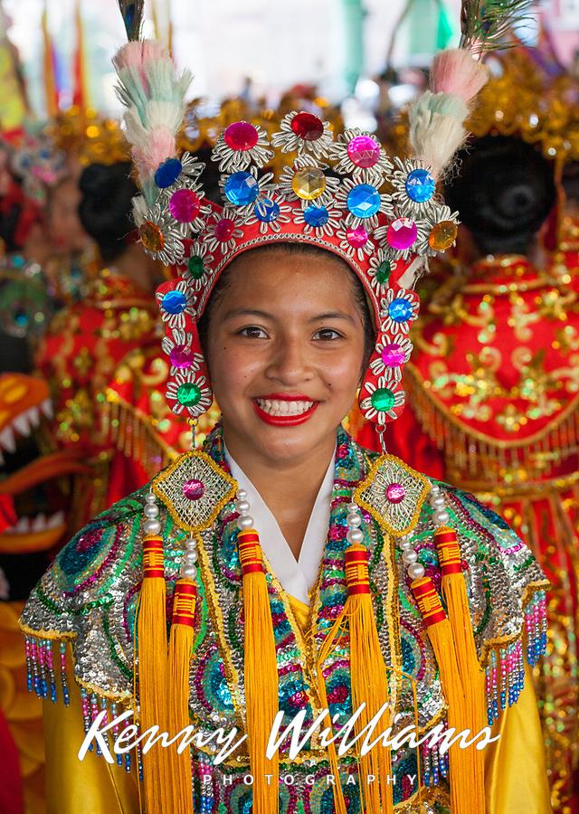 Beautiful asian girl wearing multicolored jeweled headdress, Chinese Girls Drill Team, Chinatown Seafair Parade 2015, Seattle, Washington State, WA, America, USA.