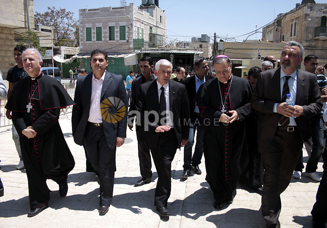 The head of the Roman Catholic Church in the Holy Land, the Latin Patriarch of Jerusalem Fuad Twal walks among Palestinian officials near the Ibrahimi Mosque, or Tomb of the Patriarchs, during a visit to the divided West Bank city of Hebron on June 20, 2011. Photo by Najeh Hashlamoun..