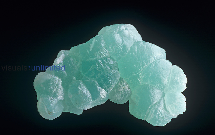 Smithsonite (ZnCO3), a secondary mineral found in the oxidized zone of ore deposits and derived from the alteration of primary Zinc minerals.