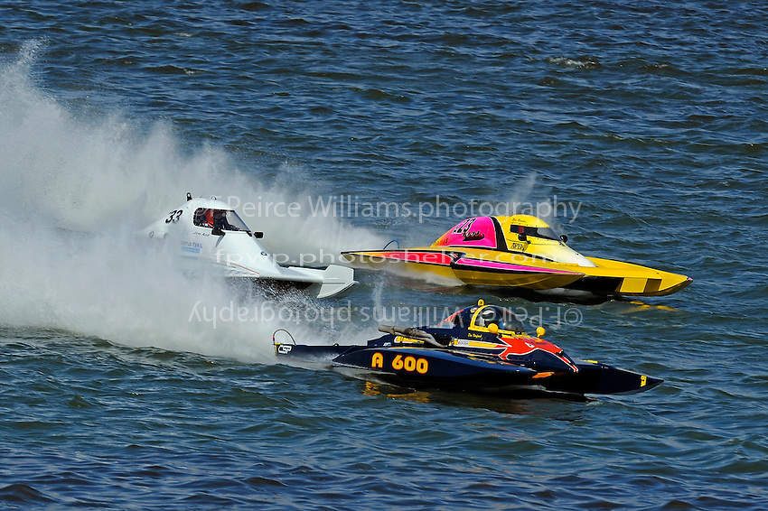 """Jim Aid, A-33 """"In Cahoots Again"""", Mike Monohan, A-23 """"Geezerboat"""" and Dan Kanfoush, A-600 """"Mr.Bud"""" race to the first turn."""