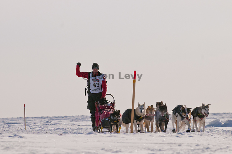 Musher rookie Braxton Peterson along Bering Sea near Nome, Alaska during Iditarod Dogsled Race, 2012