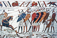 """Visual Arts:  Bayeaux Tapestry #6.  Harold's House Guards grouped tightly in a """"shield wall"""", and in the center, a single unarmed bowman. (Harold's army had few archers.)"""