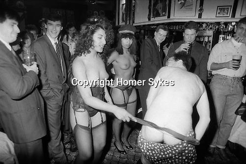 City office workers hire two Strippergram girls for a colleagues birthday present. East end London pub. 1991