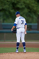 AZL Dodgers starting pitcher James Marinan (31) checks the runner at first base during an Arizona League game against the AZL White Sox at Camelback Ranch on July 3, 2018 in Glendale, Arizona. The AZL Dodgers defeated the AZL White Sox by a score of 10-5. (Zachary Lucy/Four Seam Images)