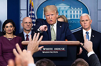 United States President Donald J. Trump calls on a reporter as he holds a  briefing on the Coronavirus COVID-19 pandemic with members of the Coronavirus Task Force in the Brady Press Briefing Room at the White House in Washington, DC, March 17, 2020, in Washington, D.C. <br /> Credit: Kevin Dietsch / Pool via CNP/AdMedia
