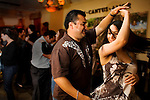 NAMES CQ: Alfredo Ruis, of San Lorenzo, and Rosa Cervantes, of Napa, dance to salsa music at the Ceja Vineyards Wine Tasting Salon, Lounge and Art Gallery, on First St., in downtown Napa, Ca., on Saturday, May 22, 2010.