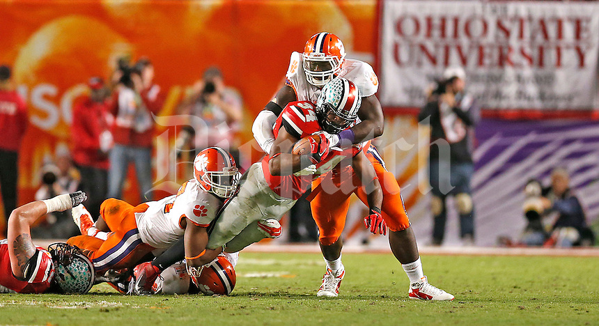 Ohio State Buckeyes running back Carlos Hyde (34) is stopped for a short gain in the second half of the 2014 Discover Orange Bowl at Sun Life Stadium in Miami Gardens, Florida on January 3, 2014. (Chris Russell/Dispatch Photo)