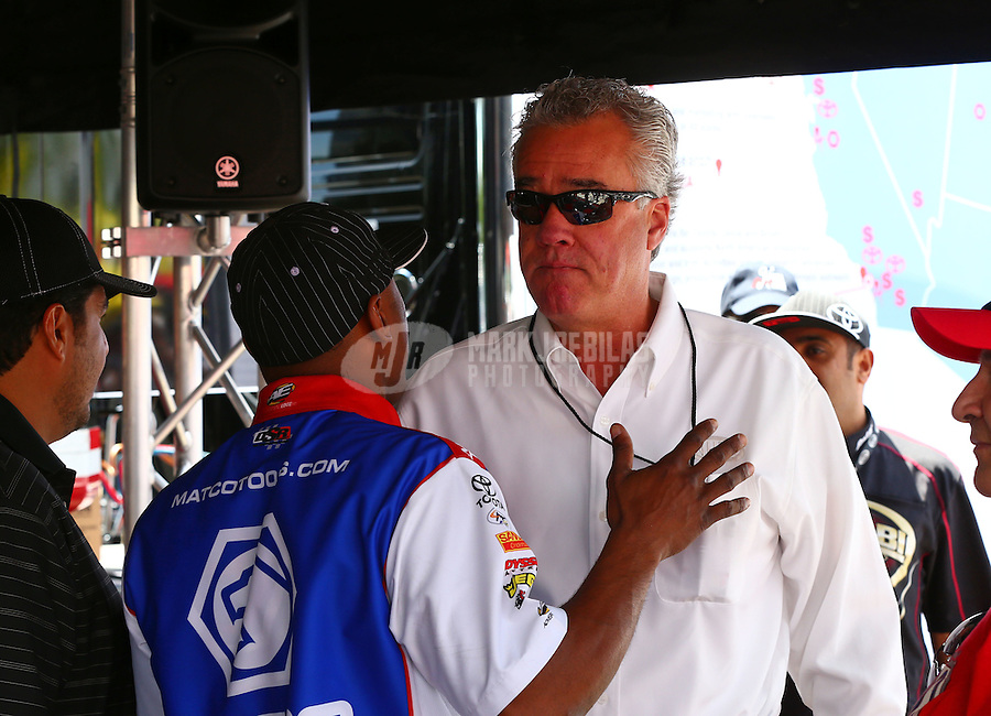 May 31, 2014; Englishtown, NJ, USA; NHRA top fuel driver Antron Brown (left) talking with NHRA official Graham Light during qualifying for the Summernationals at Raceway Park. Mandatory Credit: Mark J. Rebilas-