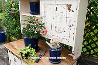 63821-203.17 Potting bench with containers and flowers in spring, Marion Co. IL