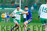Jim Cremin Ballydonoghue on the attack despite the attention of James O'Donnell St Senans at the North Kerry Championship final played in Moyvane on Sunday.