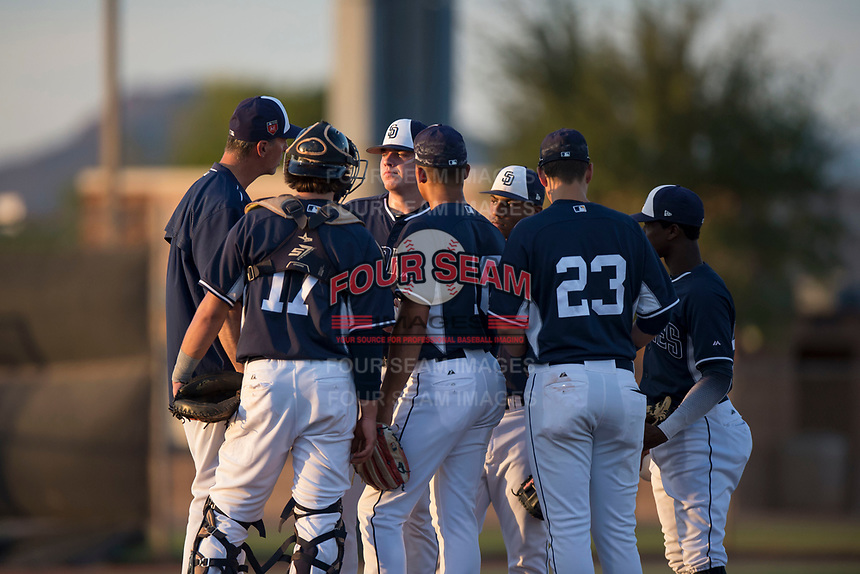 AZL Padres 2 pitching coach John Halama (52) talks to starting pitcher Ryan Weathers (40) among a gather infield during an Arizona League game against the AZL Padres 1 at Peoria Sports Complex on July 25, 2018 in Peoria, Arizona. The AZL Padres 1 defeated the AZL Padres 2 10-1. (Zachary Lucy/Four Seam Images)