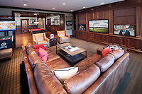 This home's basement gaming area keeps everyone busy for hours yet continuously connected via Savant Systems home control
