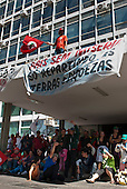 Brasilia, Brazil. Via Campesino protest in Brasilia, 23rd August 2011; men and women occupying the ministry building (Ministerio da Fazenda), in front of the ministry building.