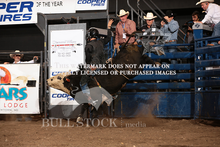 Zac Peterson attempts to ride Dakota Rodeo/Chad Berger/Clay Struve/Heald Pro Bulls's Wind Jammer during the first round of the Bismarck Real Time Pain Relief Velocity tour PBR. Photo by Andy Watson
