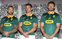 Francois Hougaard with Jesse Kriel and Frans Steyn during the South African Official Springbok team photograph at the team hotel Southern Sun Pretoria Hotel,Pretoria South Africa. 9th June 2017(Photo by Steve Haag Sports)