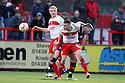 James Dunne and Mark Roberts of Stevenage battle with Gary Alexander of Crawley. Stevenage v Crawley Town - npower League 1 -  Lamex Stadium, Stevenage - 15th December, 2012. © Kevin Coleman 2012..