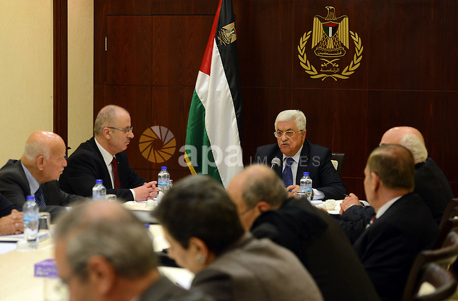 Palestinian President, Mahmoud Abbas (Abu Mazen) meets with the members of Executive Committee in the West Bank city, of Ramallah, on March 19, 2015. Photo by Thaer Ganaim