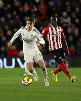 Pictured: Tom Carroll of Swansea (L) Sunday 01 February 2015<br /> Re: Premier League Southampton v Swansea City FC at ST Mary's Ground, Southampton, UK.