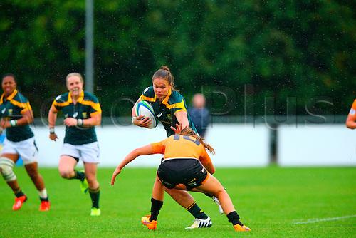 23.08.2015. Dublin, Ireland. Women's Sevens Series Qualifier 2015. Netherlands versus South Africa Marithy Pienaar (South Africa) hands off a tackle from Pleuni Kievit (Netherlands).