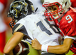 Lawndale, CA 09/26/14 - Andrew Phillips (Peninsula #16) and Michael Estrada Alvarez (Lawndale #9) in action during the Palos Verdes Peninsula vs Lawndale CIF Varsity football game at Lawndale High School.  Lawndale defeated Peninsula 42-21