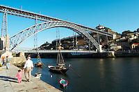Dom Luis I bridge seen from Cais da Ribeira barco rabelo shipping boat porto portugal