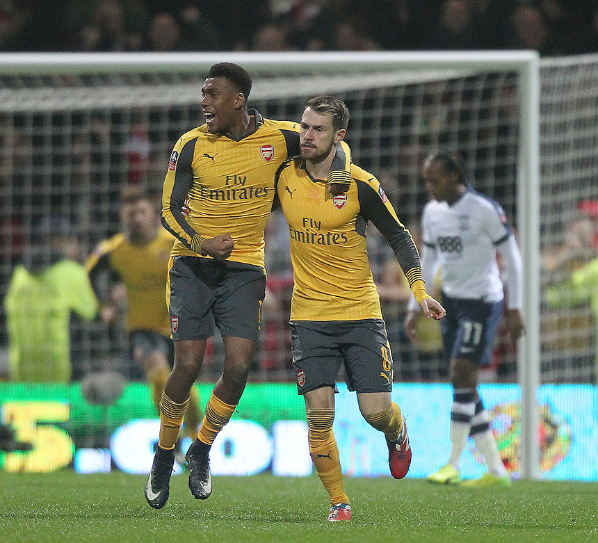 Arsenal's Aaron Ramsey celebrates scoring his sides first goal  with  Alex Oxlade-Chamberlain<br /> <br /> Photographer Mick Walker/CameraSport<br /> <br /> Emirates FA Cup Third Round - Preston North End v Arsenal - Saturday 7th January 2017 - Deepdale - Preston<br />  <br /> World Copyright &copy; 2017 CameraSport. All rights reserved. 43 Linden Ave. Countesthorpe. Leicester. England. LE8 5PG - Tel: +44 (0) 116 277 4147 - admin@camerasport.com - www.camerasport.com