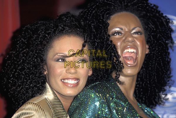 MELANIE B.With wax work model lookalike of herself, London,.07 December 1999..portrait headshot Mel G Scary Spice Girls bad skin spotty .ref:9225.www.capitalpictures.com.sales@capitalpictures.com.©Capital Pictures