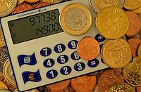 A Euro converter amongst Euro coins.