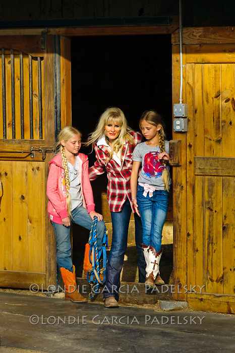 Western portrait of mom with twin daughters. At their ranch in San Luis Obispo, California (Susan Madonna)