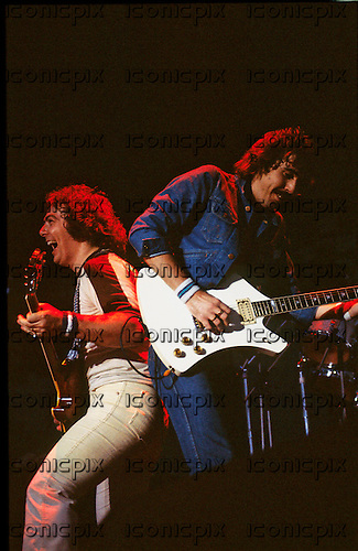 WHITESNAKE - guitarists Bernie Marsden and Micky Moody - performing live at the Monsters of Rock Castle Donington UK - 22 Aug 1981.  Photo credit: PG Brunelli/IconicPix