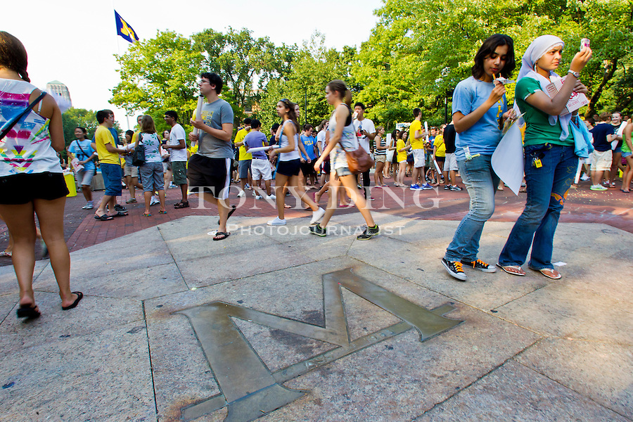 "The center-piece of the Diag is a brass inlaid ""M"" in the center of the quad where incoming freshman learn quickly the myth that stepping on it can jinx you to fail that first exam, Friday, Sept. 2, 2011 in Ann Arbor, Mich. (Tony Ding for The New York Times)"
