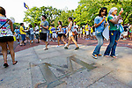 """The center-piece of the Diag is a brass inlaid """"M"""" in the center of the quad where incoming freshman learn quickly the myth that stepping on it can jinx you to fail that first exam, Friday, Sept. 2, 2011 in Ann Arbor, Mich. (Tony Ding for The New York Times)"""
