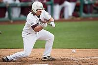 Luke Voit #30 of the Missouri State Bears lays down a bunt during a game against the Wichita State Shockers at Hammons Field on May 4, 2013 in Springfield, Missouri. (David Welker/Four Seam Images)