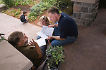 """Andrew and Patricia Nimelman cosult with Donna Smith (otherwise known as """"Your Backyard Farmer) at their home in NE Portland, OR, where they are receiving their monthly installment of plant starts, seeds and instructions."""