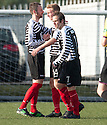Shire's Scott Maxwell (14) is congratulated by Michael Bolochoweckyj (left) and Ross O'Donoghue after he scores their third goal.