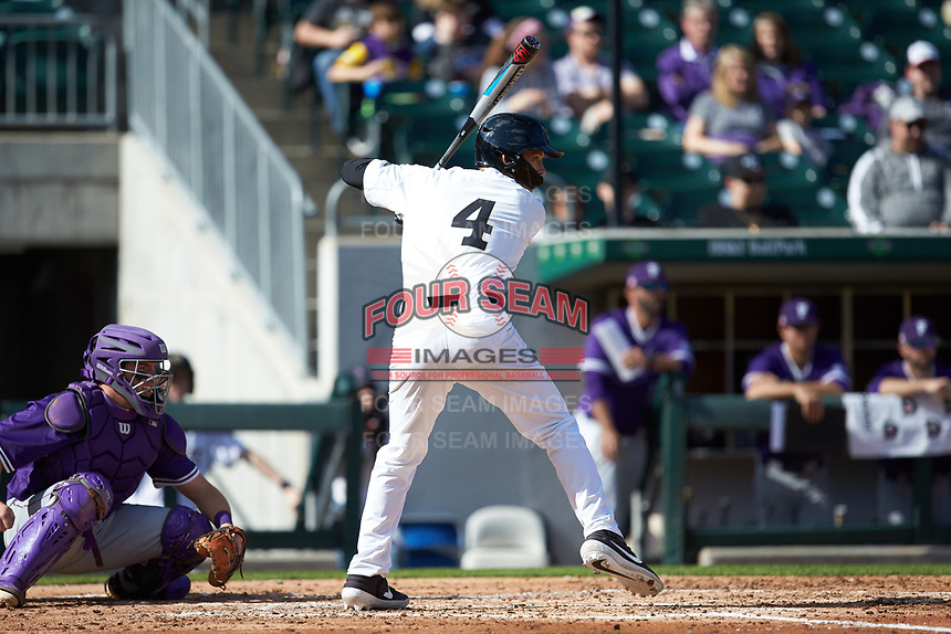 DJ Poteet (4) of the Wake Forest Demon Deacons at bat against the Furman Paladins at BB&T BallPark on March 2, 2019 in Charlotte, North Carolina. The Demon Deacons defeated the Paladins 13-7. (Brian Westerholt/Four Seam Images)