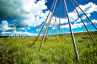 Teepees commemorating the people who perished during the Nez Perce War of 1877 stand in the tall grass at Big Hole National Battlefield near Wisdom, Montana.