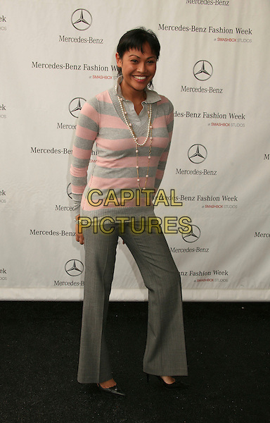 CASSANDRA HEPBURN.Mercedes-Benz Spring 2007 L.A. Fashion Week Arrivals - Day 2 held at Smashbox Studios, Culver City, California, USA..October 16th, 2006.Ref: ADM/BP.full length grey gray pink striped stripes top trousers.www.capitalpictures.com.sales@capitalpictures.com.©Byron Purvis/AdMedia/Capital Pictures.