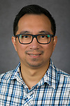 Gerard Panganiban, Web Designer, Digital Services, Teaching/Learning Resources, DePaul University, is pictured in a studio portrait Sept. 28, 2017. (DePaul University/Jeff Carrion)