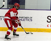 WORCESTER, MA - FEBRUARY 08: Nadia Mattivi #6 of Boston University brings the puck forward during a game between Boston University and College of the Holy Cross at Hart Center Rink on February 08, 2020 in Worcester, Massachusetts.