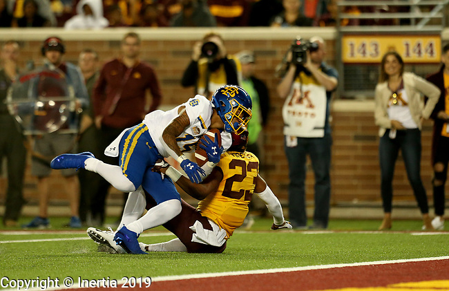 MINNEAPOLIS, MN - AUGUST 29: Cade Johnson #15 from South Dakota State University is brought down by Jordan Howden #23 from the University of Minnesota just short of the goal line during their game Thursday night at TCF Bank Stadium in Minneapolis, MN. (Photo by Dave Eggen/Inertia)