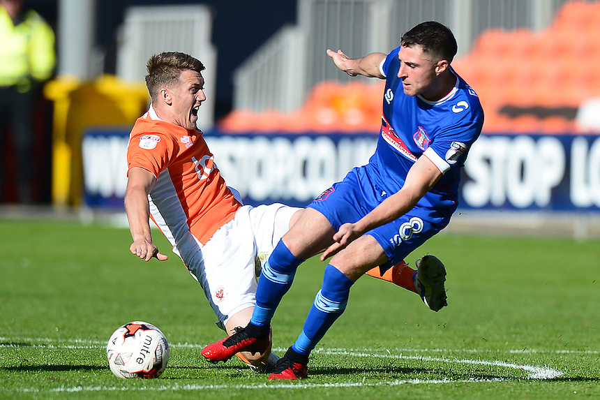 Blackpool's Jim McAlister is challenged by Carlisle United's Mike Jones<br /> <br /> Photographer Richard Martin-Roberts/CameraSport<br /> <br /> The EFL Sky Bet League Two - Blackpool v Carlisle United - Saturday 17 September 2016 - Bloomfield Road - Blackpool<br /> <br /> World Copyright &copy; 2016 CameraSport. All rights reserved. 43 Linden Ave. Countesthorpe. Leicester. England. LE8 5PG - Tel: +44 (0) 116 277 4147 - admin@camerasport.com - www.camerasport.com
