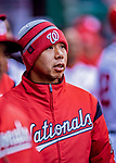 15 April 2018: Washington Nationals Assistant Athletic Trainer John Hsu keeps warm in the dugout during a game against the Colorado Rockies at Nationals Park in Washington, DC. All MLB players wore Number 42 to commemorate the life of Jackie Robinson and to celebrate Black Heritage Day in pro baseball. The Rockies edged out the Nationals 6-5 to take the final game of their 4-game series. Mandatory Credit: Ed Wolfstein Photo *** RAW (NEF) Image File Available ***